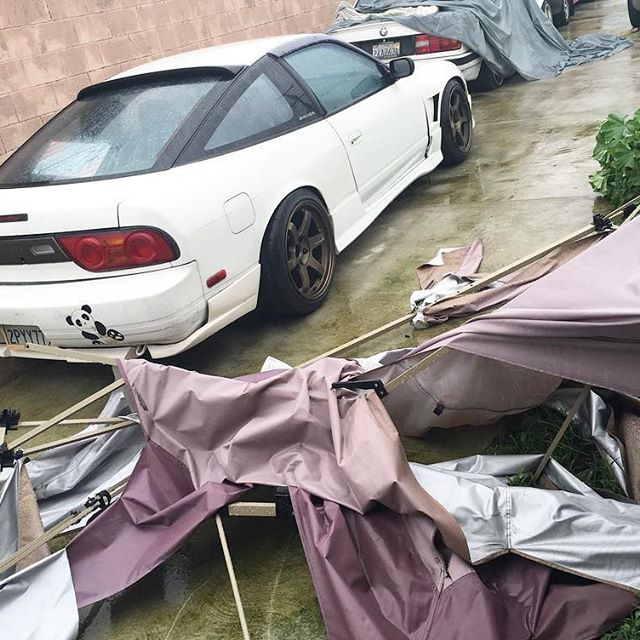 Storm WindyFriday hit our driveway taking down our tent and scratched the crap out of the track car. 🏎 luckily not major damage but still #pandasadventures #driftcar